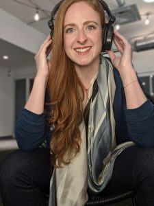 host margaux miller with headphones on